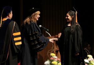 UConn President, Susan Herbst, congratulated each graduating UConn medical, dental and graduate school student (Photo by John Atashian)